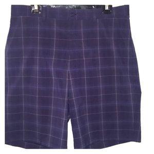 Men's navy blue plaid golf shorts.
